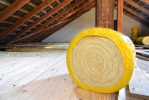 big bright colored roll of insulation ready to be installed in attic
