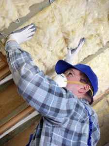 lady baltimore insulation co servicing a house in maryland installing rock wool insulation for sound proofing the attic